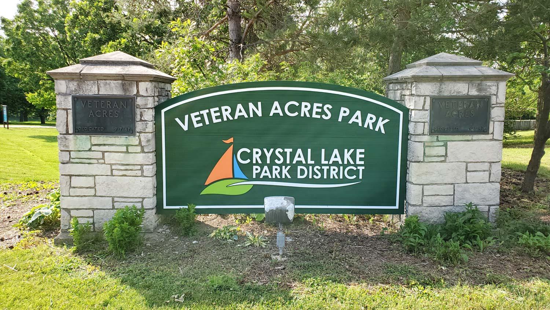 Veteran Acres Park sign and plaques at Veteran Acres Park.