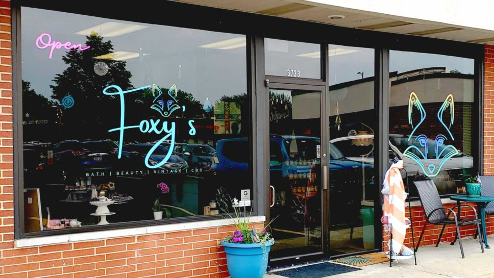 Foxy's storefront and logo.