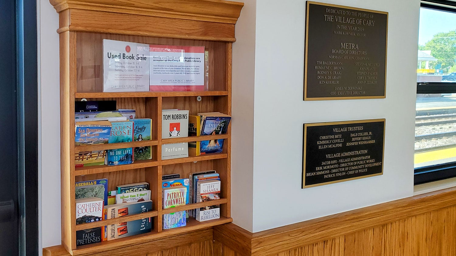 Various reading materials and commemorative plaques in the Cary station.